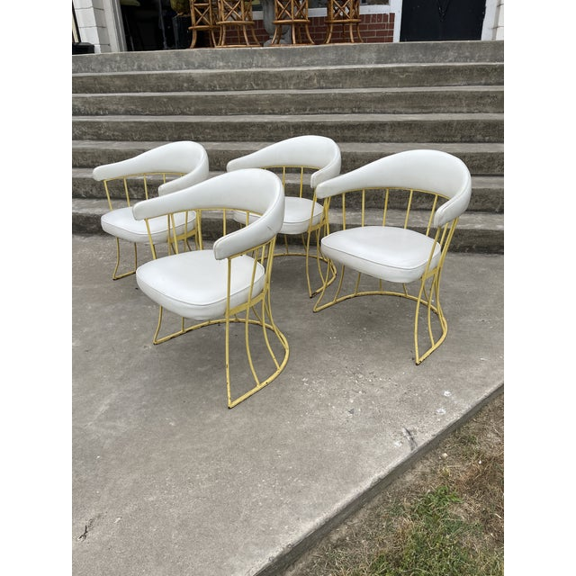 Great set of 4 8iron patio chairs in canary yellow and white vinyl cushions. Very good vintage condition. Vinyl cleans up...