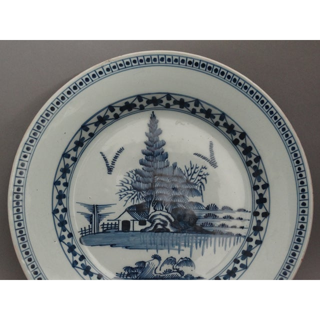 An 18th-Century English Delft charger. It is a fine quality charger, hand painted in cobalt blue and white with a...