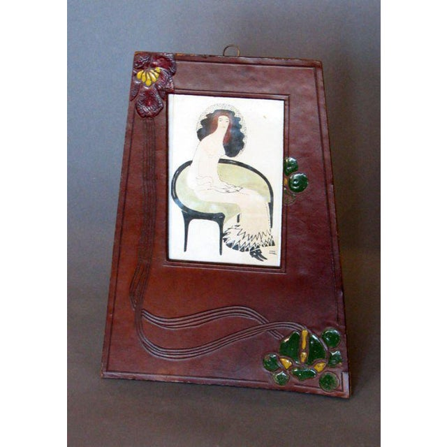 A Jugendstil period picture frame executed in leather with polychrome floral decoration in enamel, Vienna, circa 1910.