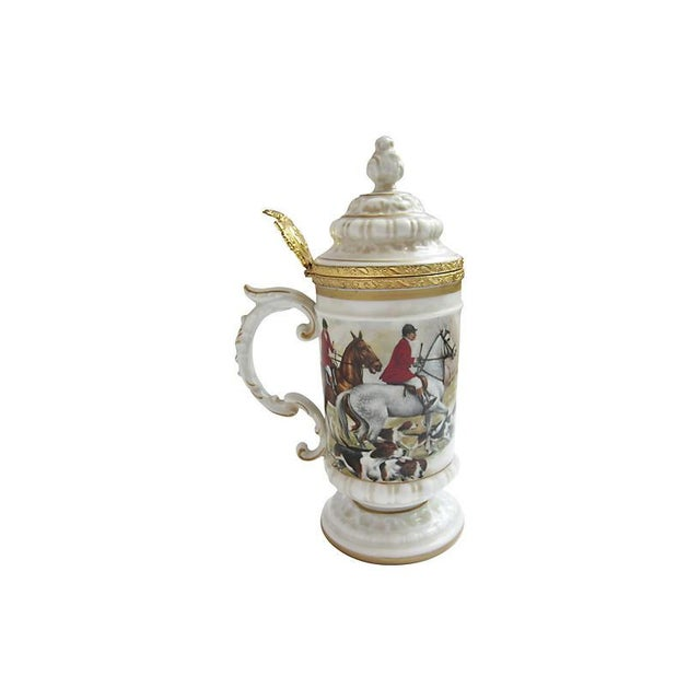 Italian hand-painted porcelain beer stein with fox hunt design, ornate gilt details, and crown-shaped thumb rest. Marked...