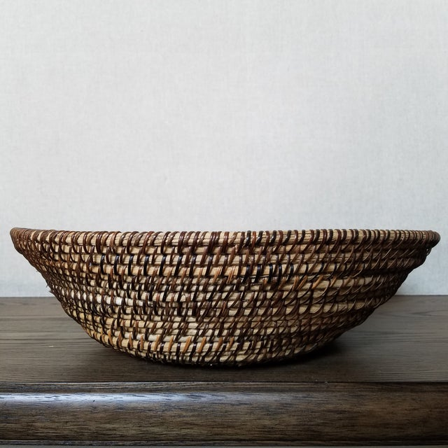 Over scale natural rattan basket bowl in a traditional coiled weave. The basket would look great as a decorative bowl, or...