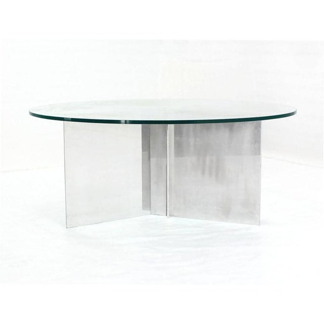 Aluminum interlocking blades base coffee table with glass top.