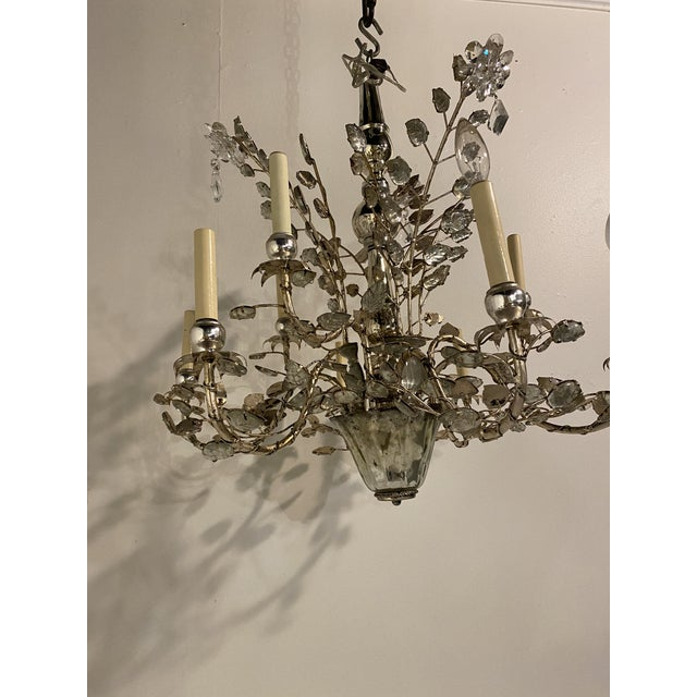 A circa 1930's French chandelier with 9 lights with glass leaves and crystals flowers(3 available)