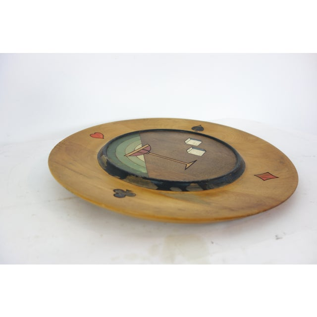 This is a gambling themed platter made by Seceni around the 1940's. This platter features a martini glass with two die and...
