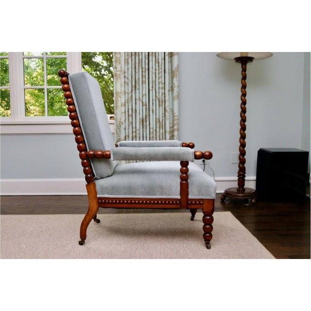 Classic 20th Century Upholstered English Bobbin Turned Lounge Chair On Castors This is a fantastic 20th century...