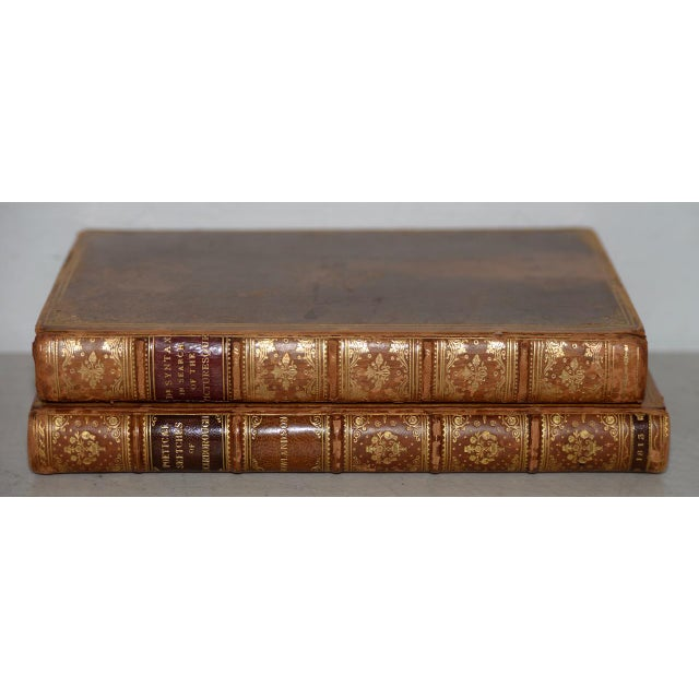 Pair of Early 19th Century Books with Engravings by Rowlandson. Fine pair of leather-bound books with color engravings by...