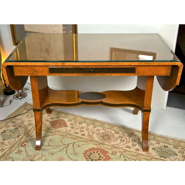 Beautiful satinwood sofa table with figurative inlay, drop leaf ends and center drawer.