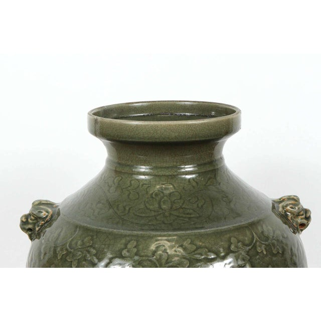 Large-scale polished Celadon green porcelain vase, early 20th century. Decorated with flowers pattern and covered with...