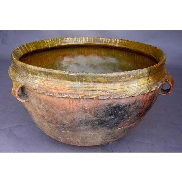 """Beautiful terracotta """"olla"""" (water storage pot) with green interior glaze, bas relief and applied twisted banding."""