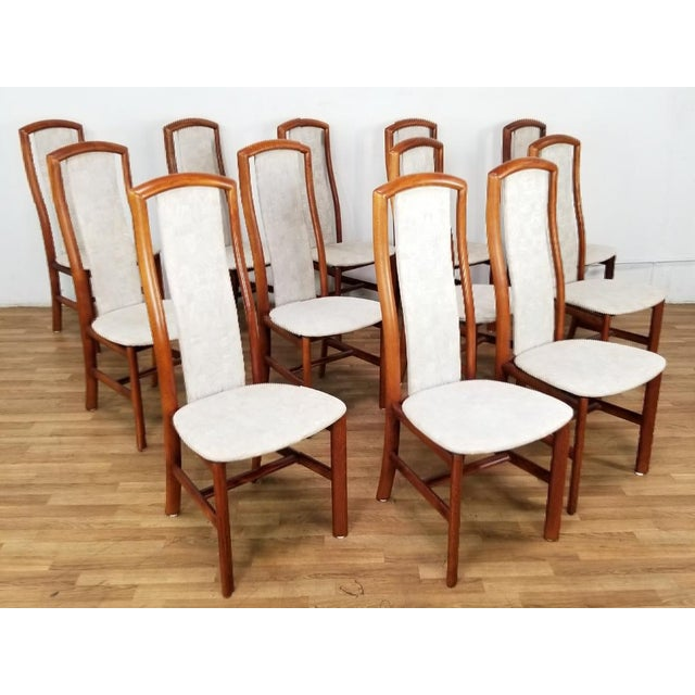 Beautiful Set of 12 Danish Mid-Century Dining Chairs perfect for a comforting dining experience. Eat in mid-century style....