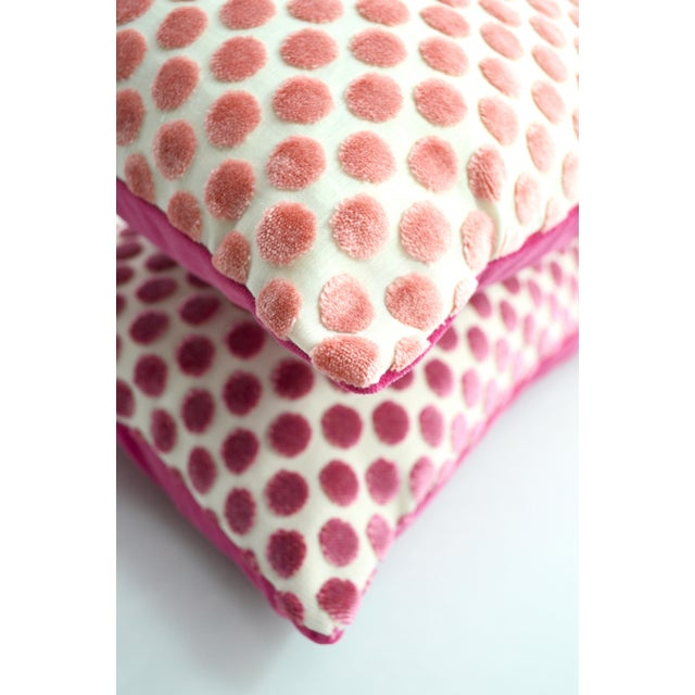 An adorable velvet pillow in a polkadot pattern and light pink from FirmaMenta. Fresh and perfect for a children's...