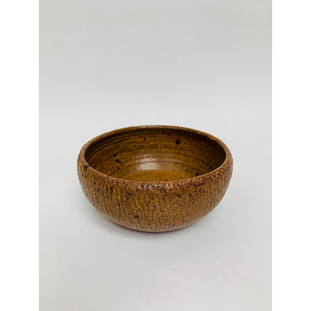 Perfect rustic, modern small bowl hand thrown by well-known Vermont studio potter George Scatchard.The bowl features a tan...