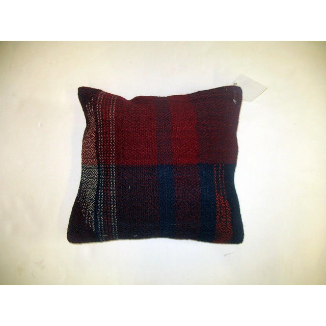 Pillow made from an american rag rug with cotton back. Zipper closure and foam insert provided. 15' x 16''