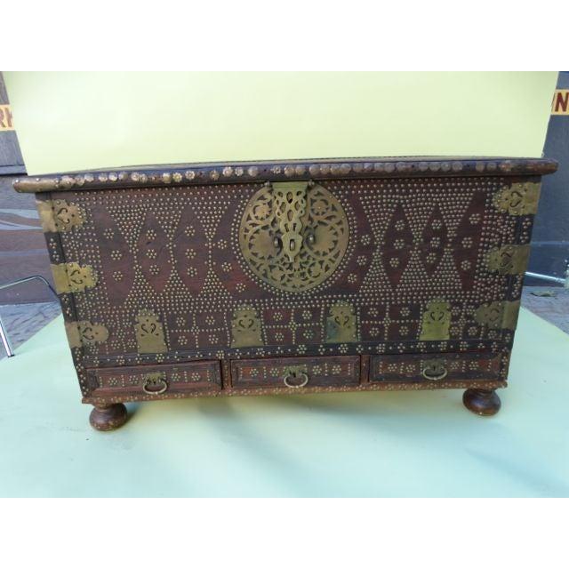 Gorgeous 19th-century teak & brass studded Moorish trunk. Incredible hand work.