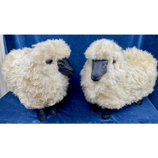 Fabulous pair of Lalanne style sheep ottomans / footstools covered in beige sheepskin. Heavy solid resin and very sturdy...