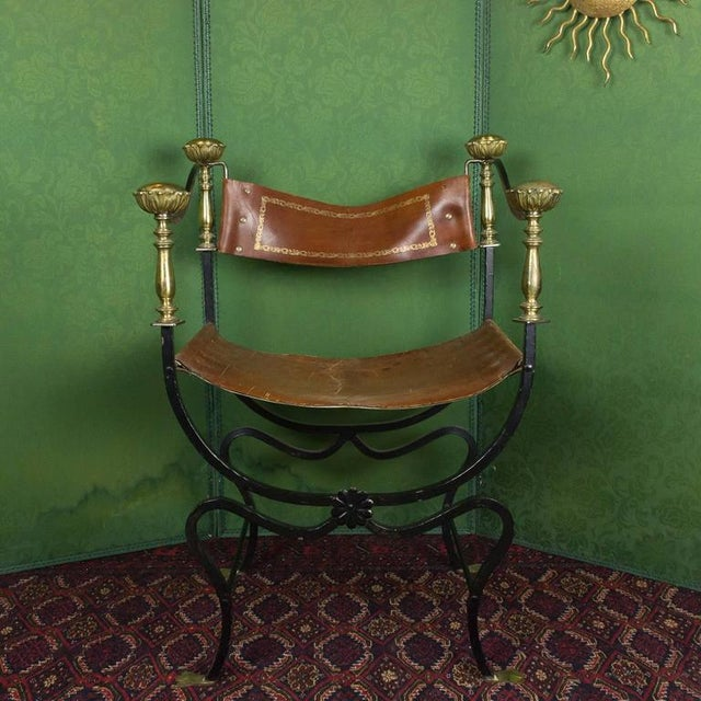 Italian iron Campaign chair with brass details and leather seat and back. Made in the early 20th century.
