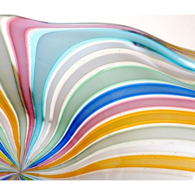 Colorful Murano hand blown rainbow Filigrana ribbons Italian art glass bowl. Documented to designer Fratelli Toso,...