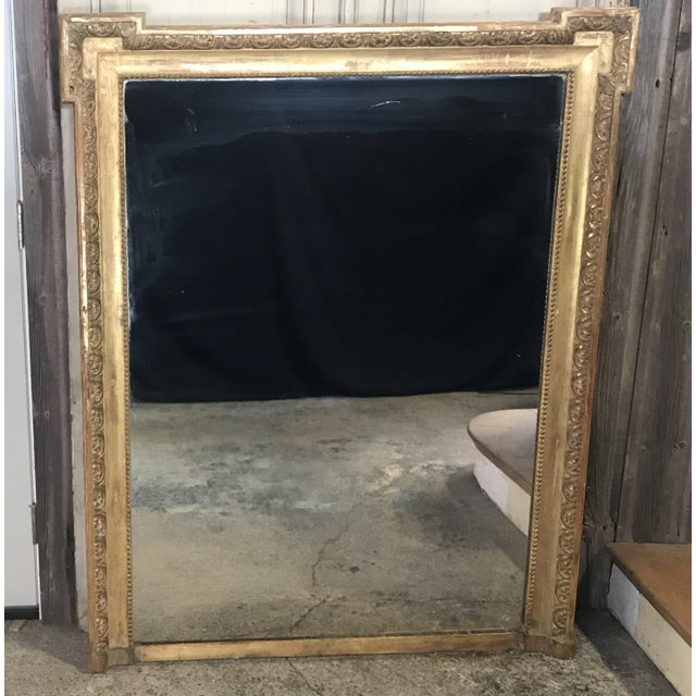 Very impressive French antique Louis XIV giltwood carved mirror. Can serve beautifully as a floor, wall or mantel mirror....