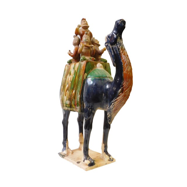 "This is a handmade oriental ancient style camel figure in the vintage finish. Dimensions: 15"" x 8"" x h24"" Origin: China..."