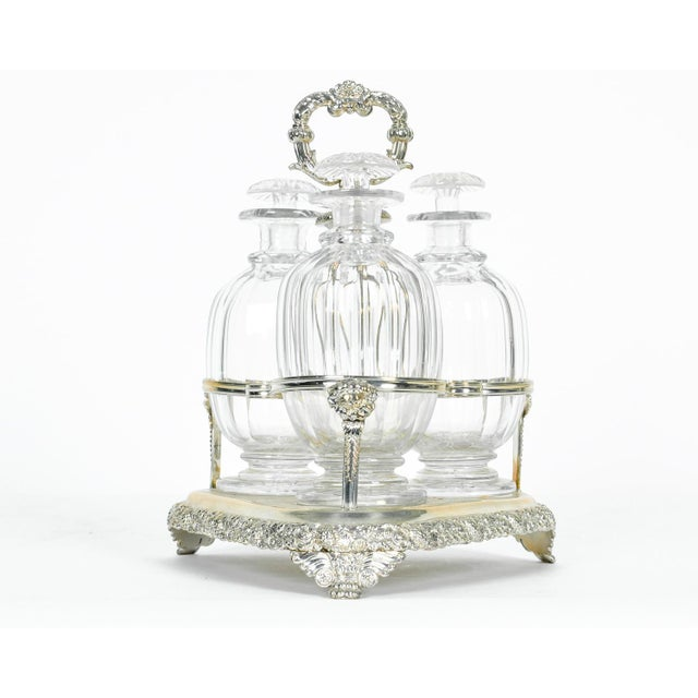 Old English Sheffield silver plated with cut crystal three bottles decanter set. All in excellent condition. The decanter...