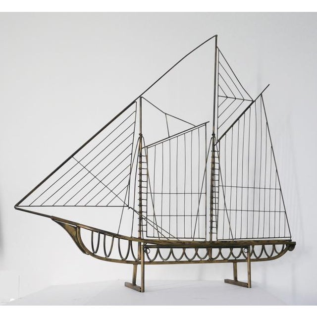 Mid-Century Modern ship sculpture attributed to Curtis Jeré. This oversized art piece is made of brass. It looks like a...