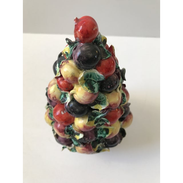 Beautiful Majolica fruit topiary. Mid-Century and hand painted in the majolica style. I can't decide if the fruit is a...