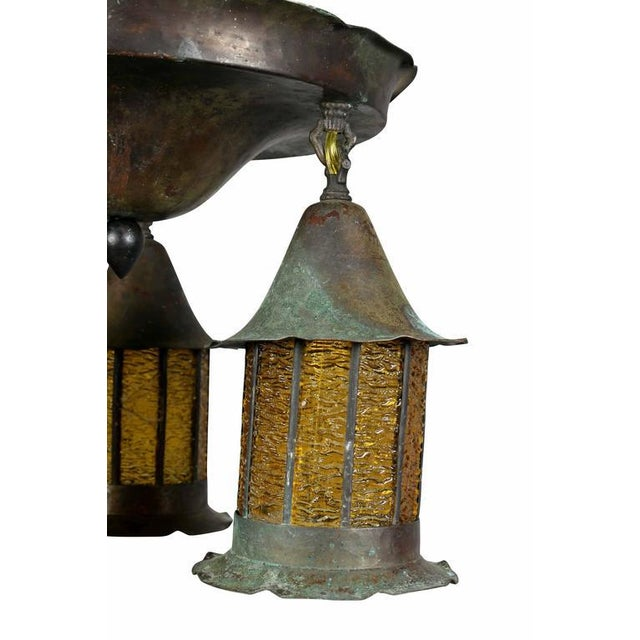 With domed flush fitting cap with three suspended lamps each with amber rippled glass. Rewired.
