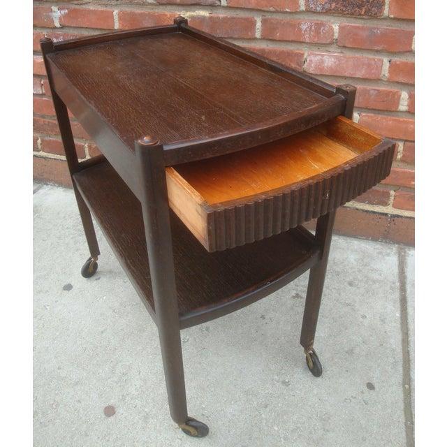 Rare solid oak Streamline Moderne / Art Deco rolling barcart or tea service cart with wonderful lines. We note the shelf...