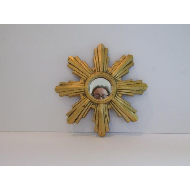 Beautiful, petite, perfectly shaped wooden starburst mirror by Jaru Company