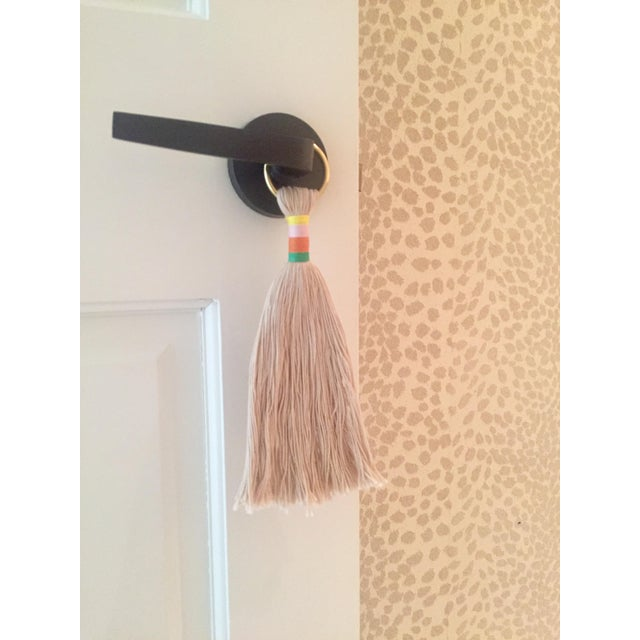 Our handmade 'reed' multi-color hemp wrapped, beige cotton tassel door or wall hanger on gold ring is a quick & fun...