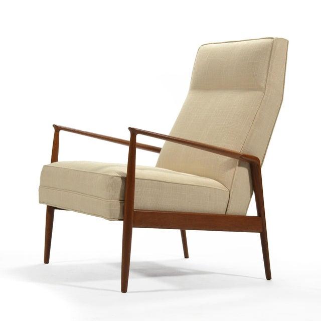 This beautiful, stately design by Kofod-Larsen is Classic Danish modern. The teak frame has wonderful sculptural details...