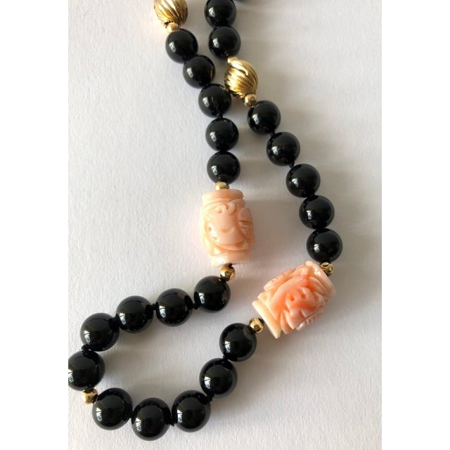 "Beautiful black onyx, angel skin coral with 14k gold bead separators, circa late 1940's or early 1950's. 31"" length...."