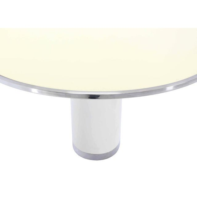 Mid-century modern heavy beautifully enameled steel with chrome banding single pedestal round center or gueridon table....