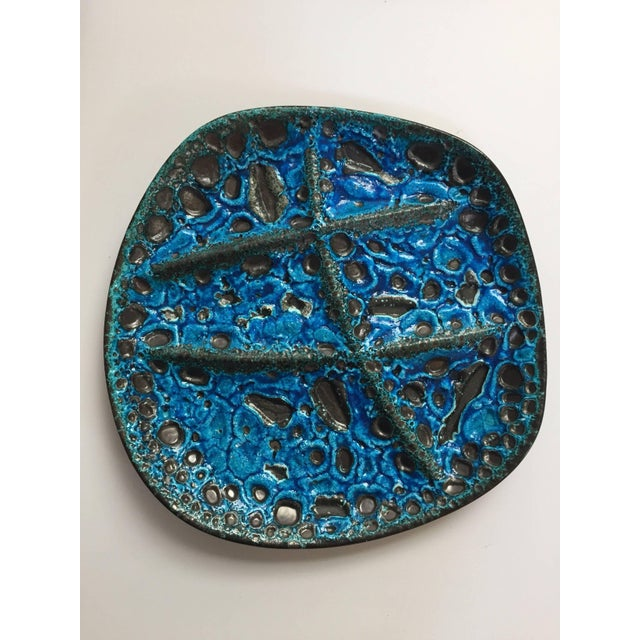 French Mid-Century Modern, set of three glazed painted stoneware decorative plates in blue and black lava. As its name...