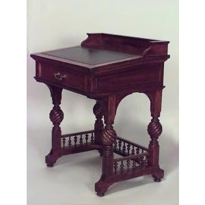 American Victorian mahogany slant front desk with gallery and turned legs and spindle design stretcher (signed HERTS...