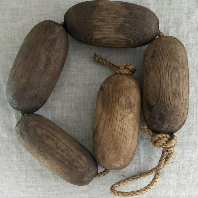From the Oregon coast, instant nautical charm with these wood fishing floats on a rope, over 3 feet in length. Display...