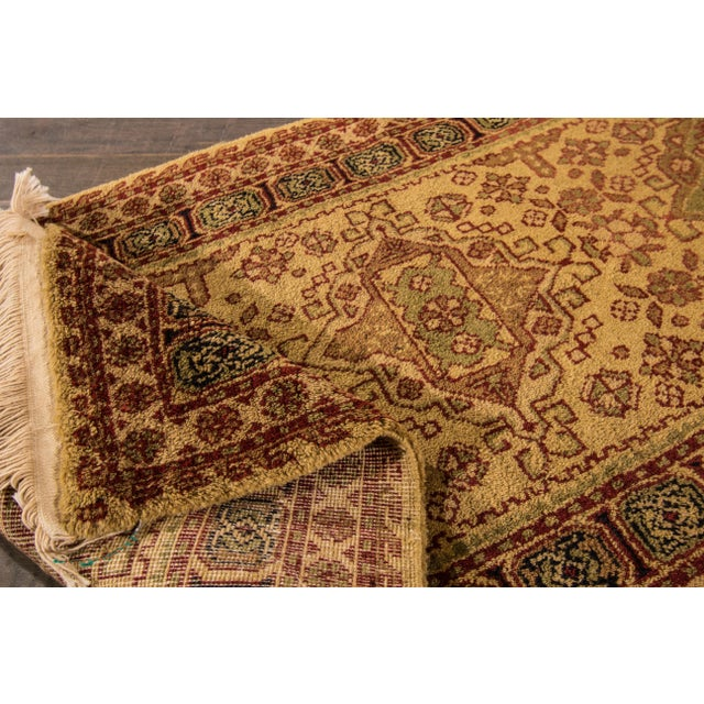 Vintage hand-knotted Tabriz rug with a geometric medallion motif. This piece has great colors and a beautiful design. It...