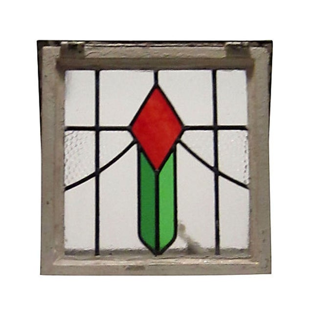 An English cottage leaded glass window with original frame. Still retains bar to allow window to adjust at different...