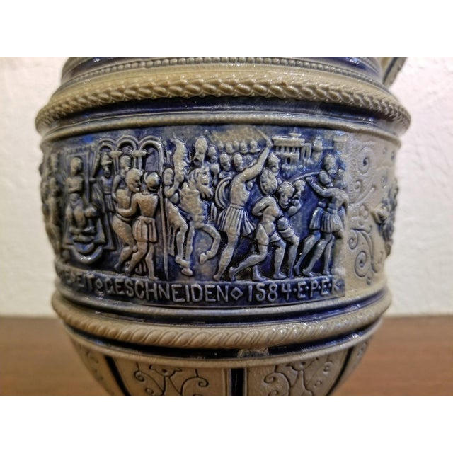 Very rare flemish pottery beer jug or stein, depicting the Story of Susanna and dated 1584. The original jug has been...