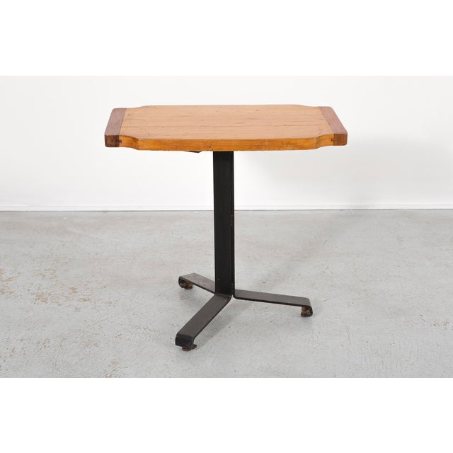 An occasional table designed by Charlotte Perriand for Les Arcs, Savoie in France, c 1968. Enameled steel and pine. This...