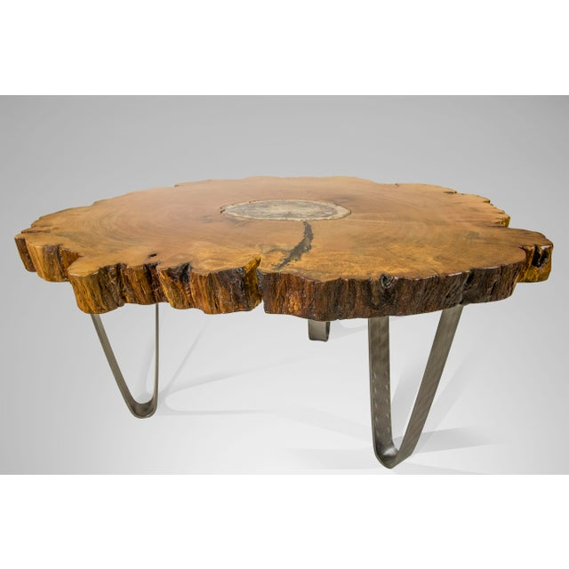 This sycamore table top contains a 200 million year old Madagascan petrified wood insert in its center. The live edge...