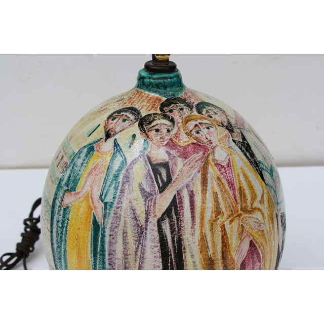 Marcel Fantoni hand-painted figural lamp signed on the base. New cast brass cluster on top and completely re-wired. A...