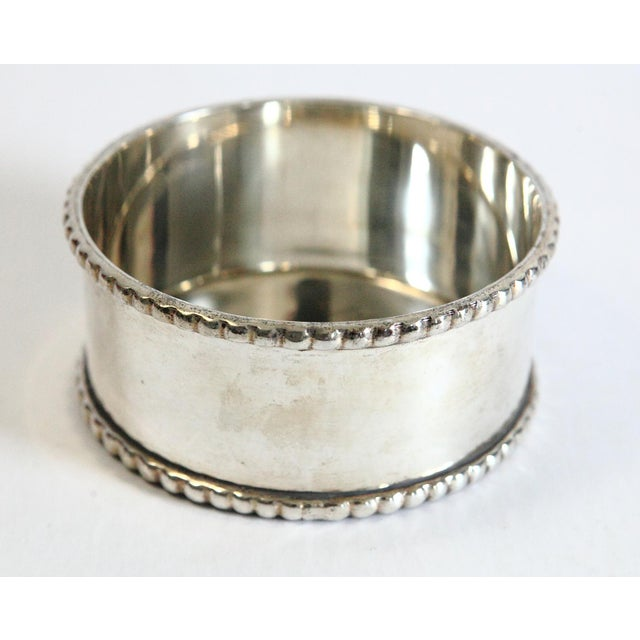 A classic silver-plated wine coaster. Nice detailed border. Holds your wine bottle. Great for entertaining.