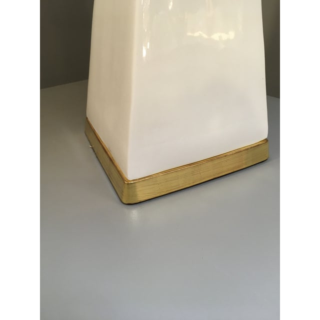 Christopher Spitzmiller lamp in clear glaze with a 23k gold water gilt base and double socket. The lamp neck can be...