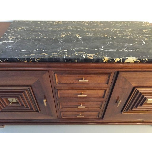 French Art Deco in the style of Maxime old mahogany marble top buffet. Four central draws flanked by cabinet doors covered...