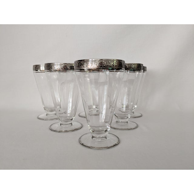 A stunning set of silver embossed crystal parfait glasses - each with a band of a raised floral design around the top...