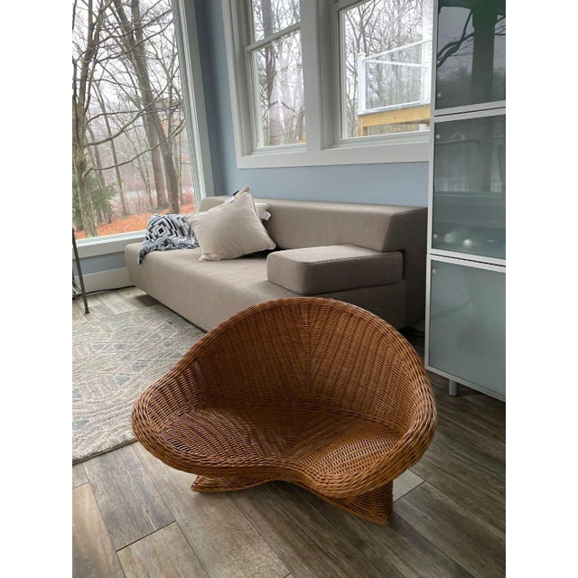 """Mid Century Wicker Chair in great condition well made very different piece. size 33"""" long , seat size is 12"""" in center and..."""