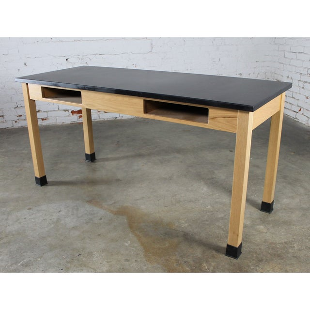 These oak lab tables with their wonderful black epoxy resin solid surface laboratory tops are really awesome. The base is...
