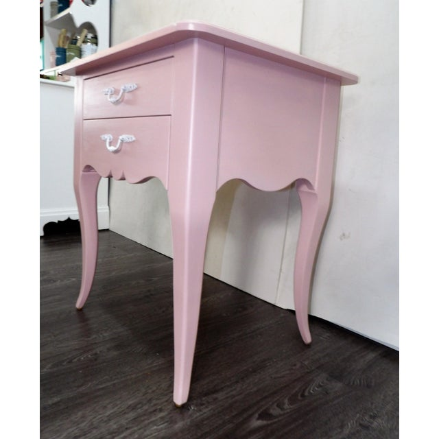 Vintage accent side table with two drawers, refinished in Pale Pink. . The side table has a delicate look, with it's...