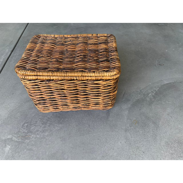 Pottery barn lidded basket or box made of hand woven rattan and wicker in excellent condition. Warm, durable, decorative....